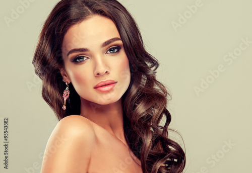Beautiful girl light brown hair with an elegant hairstyle , hair wave ,curly hai Plakat
