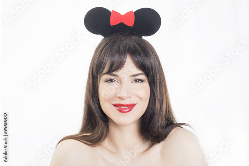 Beautiful girl smiling wearing mouse ears accessory Poster