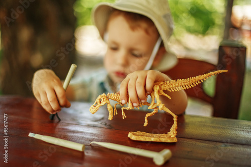 Poster little boy wants to be an archaeologist
