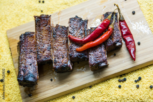 "Tasty grilled pork ribs with red pepper on the board"" Stock photo and ..."