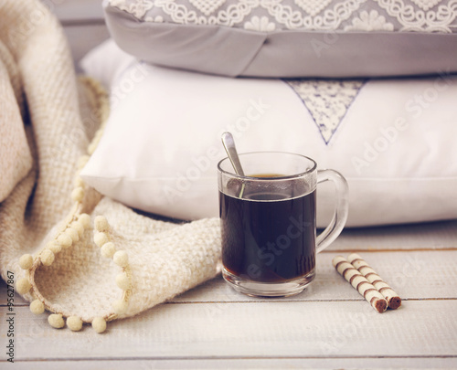 Cozy still life with coffee pillows and plaid stock for Cup cozy pillow