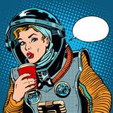 Fototapety Female astronaut drinking soda