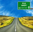 FLU SHOT road sign against clear blue sky