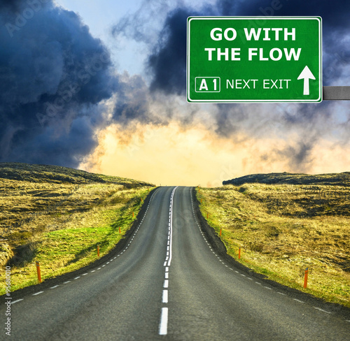 GO WITH THE FLOW road sign against clear blue sky Poster