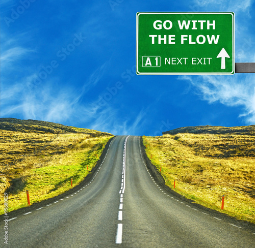 Poster GO WITH THE FLOW road sign against clear blue sky
