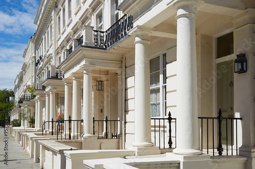 White luxury houses facades in London, perspective view Poster