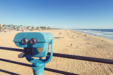 Fototapety Binoculars at Huntington Beach pier, California with vintage effect