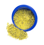 Lemon pepper seasoning spilling from blue bowl