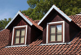 Fototapety orange tiled roof and garret windows in old house