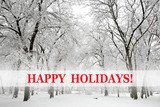 Fototapety Snow-covered trees and happy holidays text