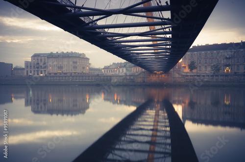 Bernatka footbridge over Vistula river in Krakow early morning © tomeyk
