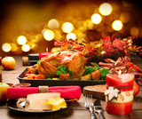 Fototapety Christmas Dinner. Roasted turkey garnished with potato, vegetables and cranberries