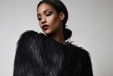 Fototapety blck woman in a black faux fur jacket