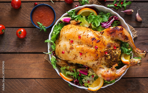 Fototapety, obrazy : Baked chicken stuffed with rice for Christmas dinner on a festive table