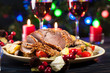 Juicy roast pork on the holiday table - 95913018