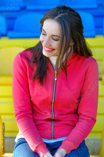 Girl cheerleader at the stadium laughing Poster