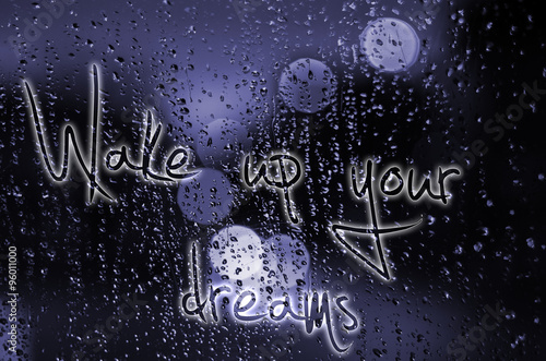 Sentence Wake up your dreams written on a wet glass Poster