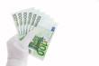 Постер, плакат: Банкноты в сто евро в руке