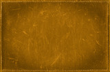 Golden grunge background from distress leather texture