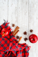 Christmas winter background, red apples with cinnamon, spices , Christmas cookies and cocoa on a white wooden background