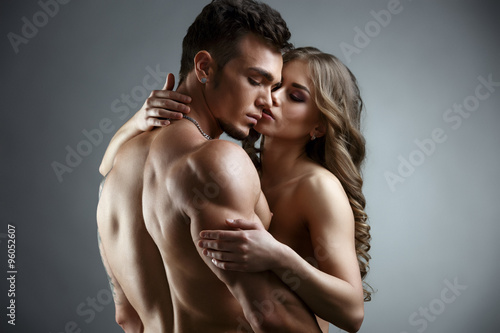 Erotica. Embrace of attractive nude couple - 96052607