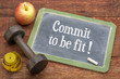 Detaily fotografie Commit to be fit - concept on blackboard