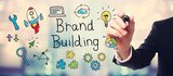 Businessman drawing Brand Building concept
