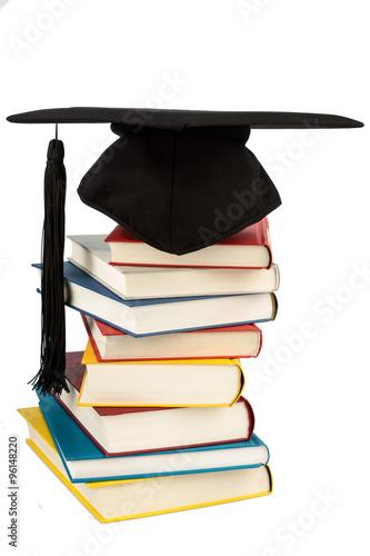 Poster Doktorhut auf Bücherstapel