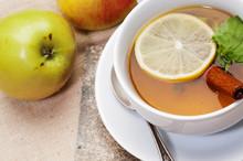 Tea with lemon, cinnamon sticks, tangerine
