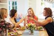 Obrazy na płótnie, fototapety, zdjęcia, fotoobrazy drukowane : Mature Female Friends Sitting Around Table At Dinner Party