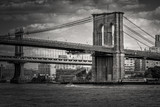 Black and white image of the Brooklyn Bridge in New York
