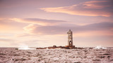 Lighthouse in the sea at sunset - Faro Mangiabarche Calasetta