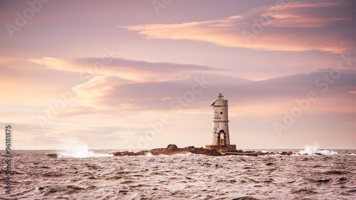 Lighthouse in the sea at sunset - Faro Mangiabarche Calasetta - 96181875