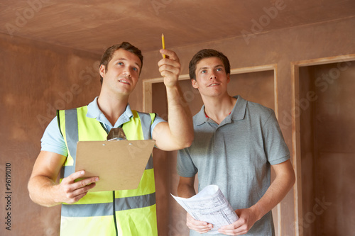 Foto Murales Builder And Inspector Looking At New Property