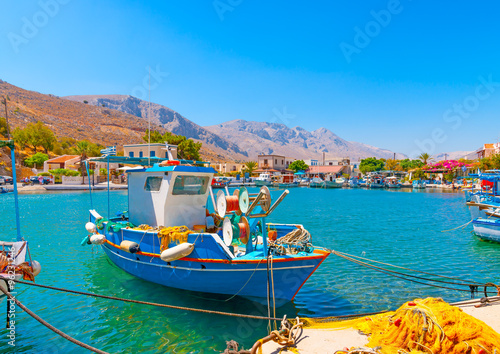 Aluminium traditional fishing boats docked at the port of Vathi village in Kalymnos island in Greece