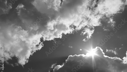 in the sky the sun breaks through the clouds. Black and white photo