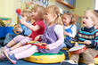 Постер, плакат: Group Of Pre School Children Taking Part In Music Lesson