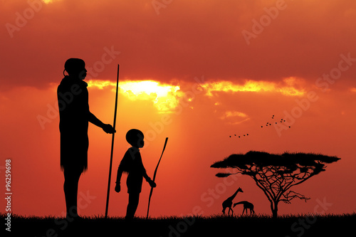 Foto op Canvas Baksteen African man and son at sunset