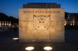 Night view of memorial stone at the World World II Memorial in Washington DC
