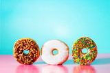 Donuts on pastel blue and pink background