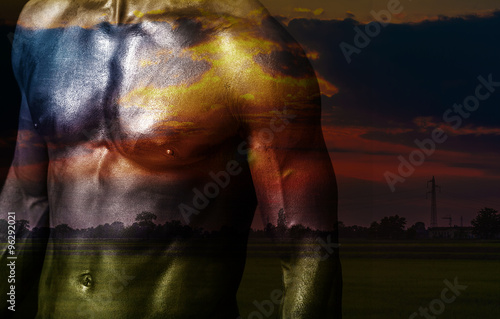 Double exposure of man chest and beautiful sunset landscape - 96292021