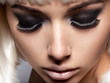 The girl's face closeup with long black lashes. fashion makeup