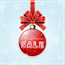 Inscription Sale on red Christmas ball