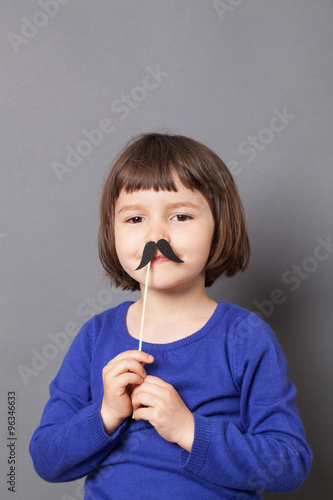 Poster kid moustache concept - happy 4-year old Charlie Chaplin look alike dressing up