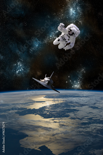 Fotobehang Nasa An astronaut drifting in space is rescued by a space shuttle - Elements of this Image Furnished by NASA.