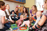 Fototapety Group Of Mothers With Babies At Playgroup