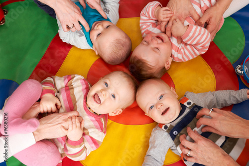 Fotografiet Overhead View Of Babies Having Fun At Nursery Playgroup