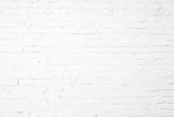 Fototapety White plastered textured brick wall