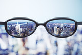 Fototapety Clear vision concept with eyeglasses and night megapolis city ba