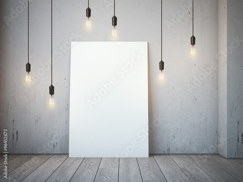 Blank white canvas with glowing bulbs in the loft interior. © ekostsov